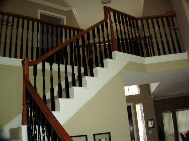 New Trend To The White Spindles On Your Staircase Paint Them Black Instead!