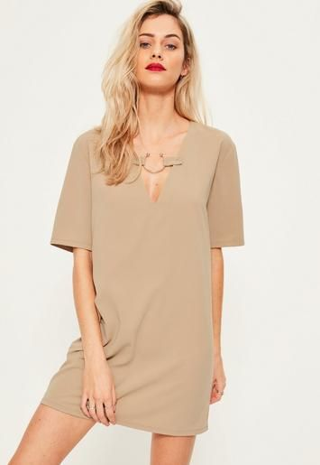 Nude never fails to impress and we're lusting over this oversized dress - featuring short sleeves, a v neckline and metal ring detail.