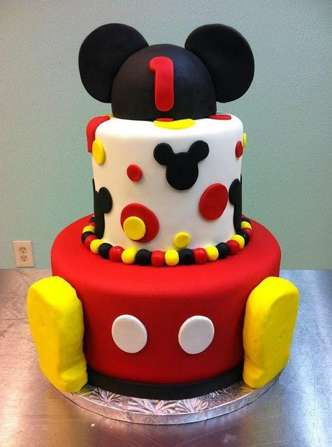 White frosting with red, yellow accents.
