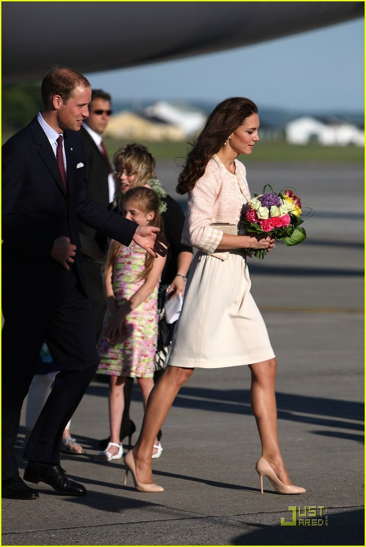 The Duke & Duchess of Cambridge arrive at Charlottetown Airport on Sunday, July 3, 2011 in Prince Edward Island, Canada during the North American Tour.  The 29-year-old Duchess of Cambridge received a bouquet of flowers from two young girls waiting at the airport.