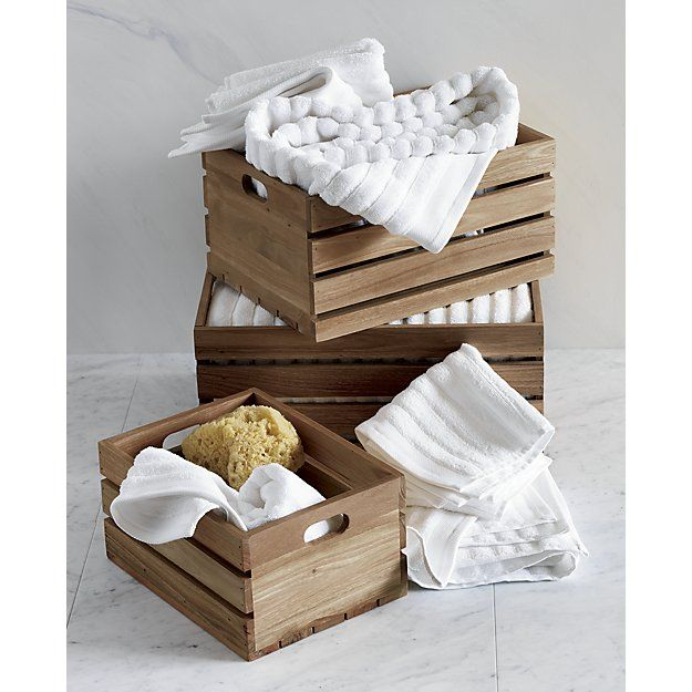Shop eucalyptus small storage box.   Decluttering gets down to earth.  Revealing naturally warm tones and smooth wood grain, beautifully spare eucalyptus planks construct a slatted design that corrals toys, magazines, accessories and other clutter.