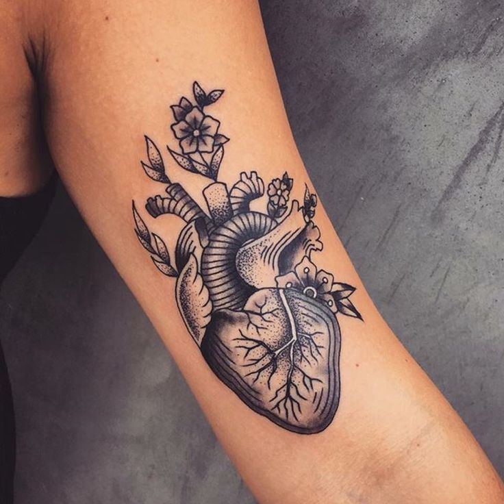 Anatomical heart and flowers tattoos by Andrea Revenant