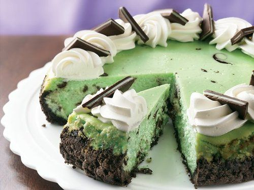 Chocolate Grasshopper Cheesecake - crust is crushed fudge mint cookies & filling is semi-sweet chocolate, cream cheese & green creme de menthe liqueur, topped with whipped cream & creme de menthe thin rectangular candies