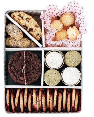 A mixed tin is a guaranteed crowd-pleaser. Line the bottom and sides of a square or rectangular airtight tin with corrugated paper. Fold short lengths in half for dividers. Envelop your cookies in tissue paper, buffer them with corrugated paper tubes, or protect them using accordion-folds of red paper. You can also tie a stack of cookies with baker's twine.