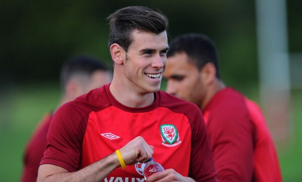 Wales player Gareth Bale raises a smile during Wales training ahead of their World Cup qualifier against Serbia at the Vale resort on September 8, 2013 in Cardiff, Wales