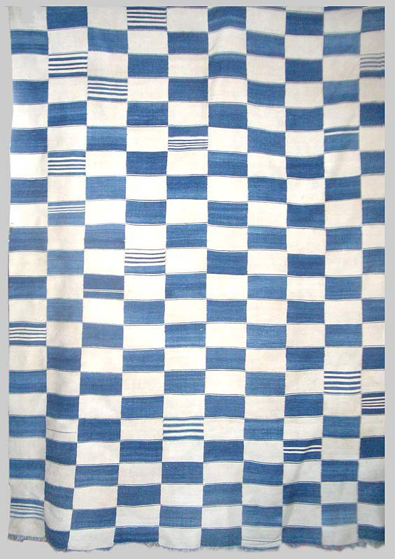 A Fulani or Dogon cotton blanket with checkerboard format. Hand spun cotton with many shades of indigo.  These blankets were worn as a mark of high rank by senior men. Similar blankets have been woven in central and west Africa for hundreds of years.