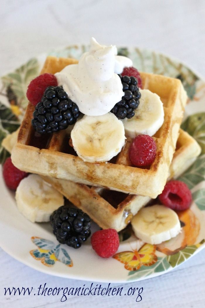 I feel I must acknowledge that around the holidays my blog tends to get a little 'carby'. Kind of like me. I will resume my regular scheduled less carby recipes after Easter. Until then feast your eyes on my 'Simple Berry Banana Buttermilk Waffles with Maple Whipped Cream'.    You may have notic