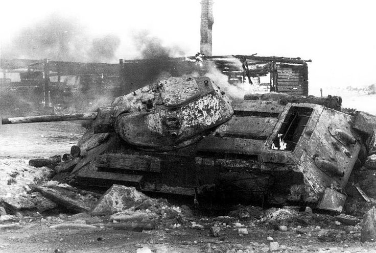 T-34 tank, knocked out near Moscow. The vehicle was built at the the end of 1941, in the plant №112 'Red Sormovo'. Hatches are closed...