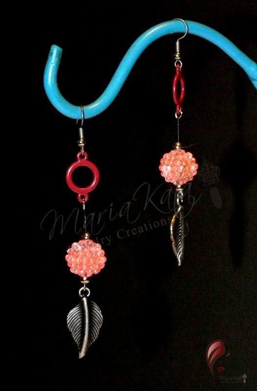 Dangle Pink seed ball earrings with metal leaves $10.00