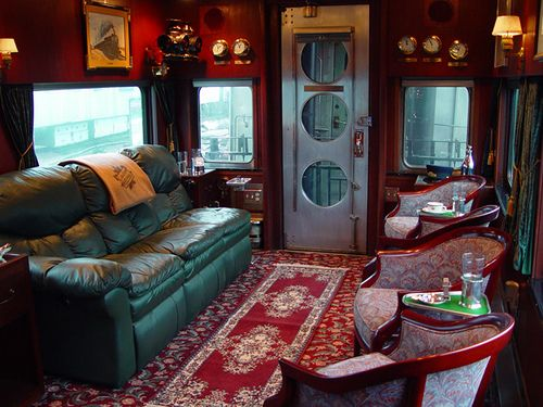 Ride across the US on a train in a Private Rail Car  (image of interior lounge by Train Chartering & Private Rail Cars, via Flickr)