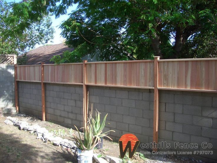 Tongue and gvoove redwood fence on prime of wall. *** See more at the image link Check more at http://westhillsfence.com/Gallery/Fences/Wood/Privacy/slides/Tongue%20and%20gvoove%20redwood%20fence%20on%20top%20of%20wall.html