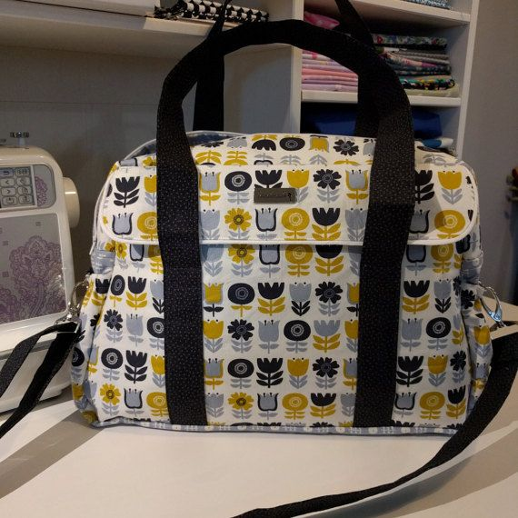 I love this fabric  https://www.etsy.com/uk/listing/274606934/baby-changing-bag-diaper-bag-over-night
