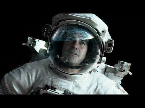 GRAVITY. Starring George Clooney and Sandra Bullock. Directed by Alfonso Cuaron.