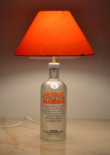 Absolut Mandrin bottle lamp with a color coordinated round shade (25.4x25.4x12.7cm) , with a brass bulb holder of regular size ,6 Feet Long Cord (Color Coordinated) & Rubber Grommet (Color Coordinated).