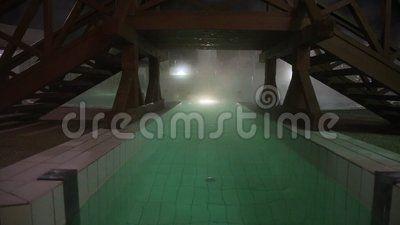 Thermal pool at night - bridge spot light underwater.