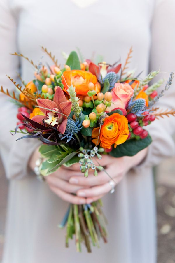 orange and purple bouquet - photo by Erica Ackroyd Photography http://ruffledblog.com/farmhouse-inspired-wedding-ideas #flowers