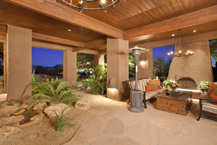 Southwest Outdoor Fireplace Patio - A covered patio like this often becomes one of the most used areas of the entire home. Regardless of weather, Winter, or Summer this outdoor room is a great design idea.