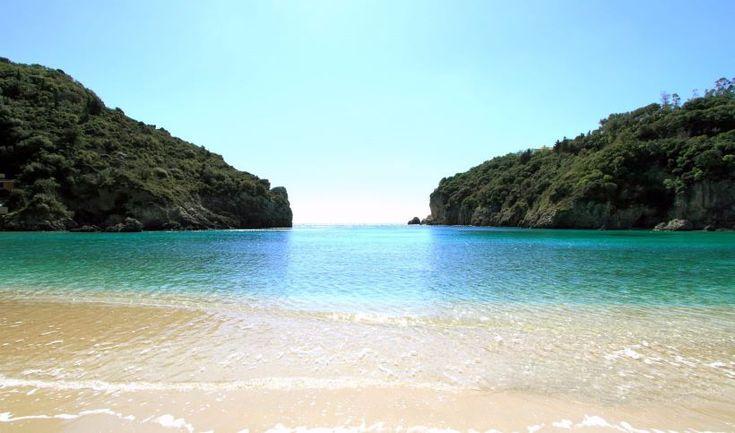 Lush green beach with blue waters, Corfu