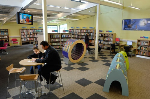 From Erin Downey Howerton - Look at the egg-shaped piece in the middle - providing a cozy, private place to curl up with a special book while also doubling as display space for highlighted titles. Everything should multitask in a well-designed library.    (Far Cotton library)