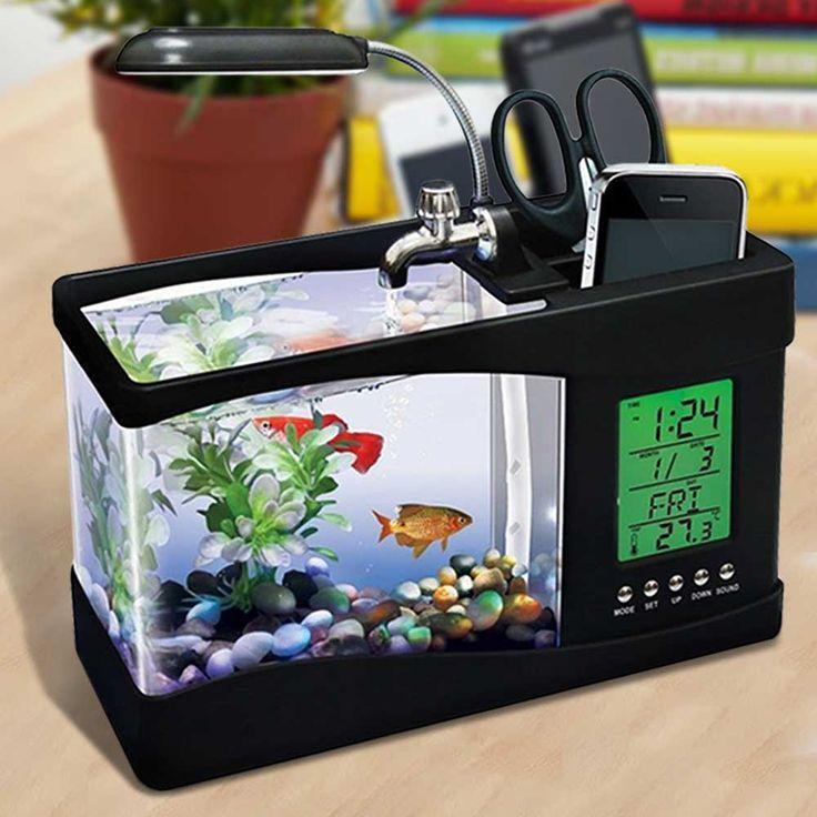 USB Desktop Aquarium - Zwart  Voel je nooit meer alleen tijdens het werk dankzij de USB Desktop Aquarium! Niet alleen jouw visvriendje kan in deze handige organizer; het is tegelijkertijd ook een klok kalender lamp én pennenbak!  EUR 22.50  Meer informatie