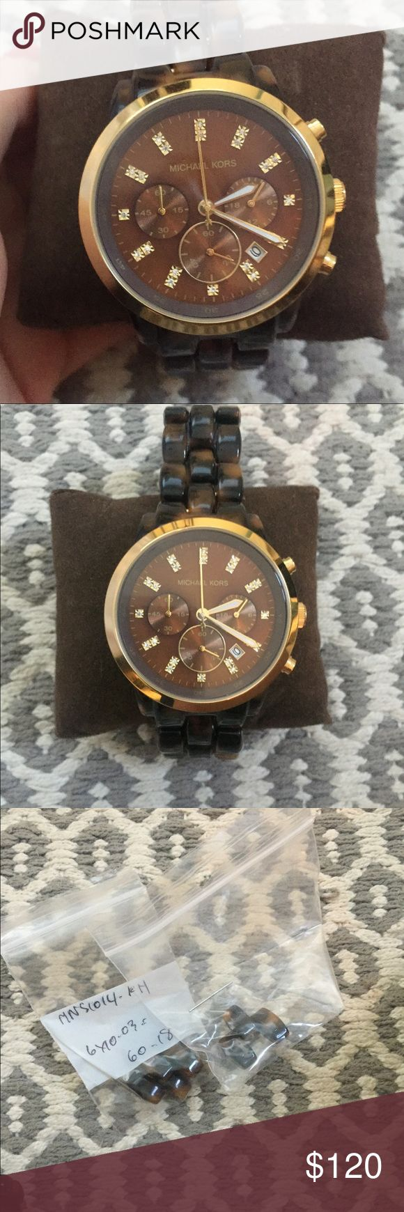 Michael Kors tortoise shell watch Michael Kors K5216 tortoise shell watch with nice diamond detailing. Needs a new battery but is BARELY worn. It was adjusted so the extra pieces come with it. Box and manual as well Accessories Watches