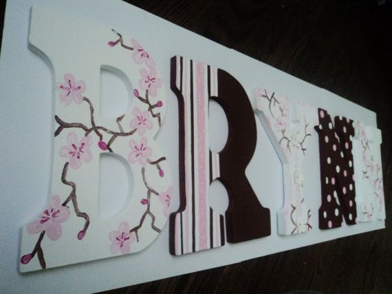 Cherry Blossom Themed Letters by ARoyalCreation on Etsy, $10.00 per letter.    Wood letters can be customized to match bedding/room decor. Perfect baby shower gift!