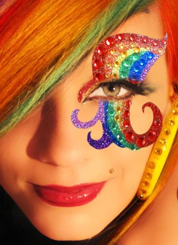 A vibrant rainbow of glitter make-up with crystals.
