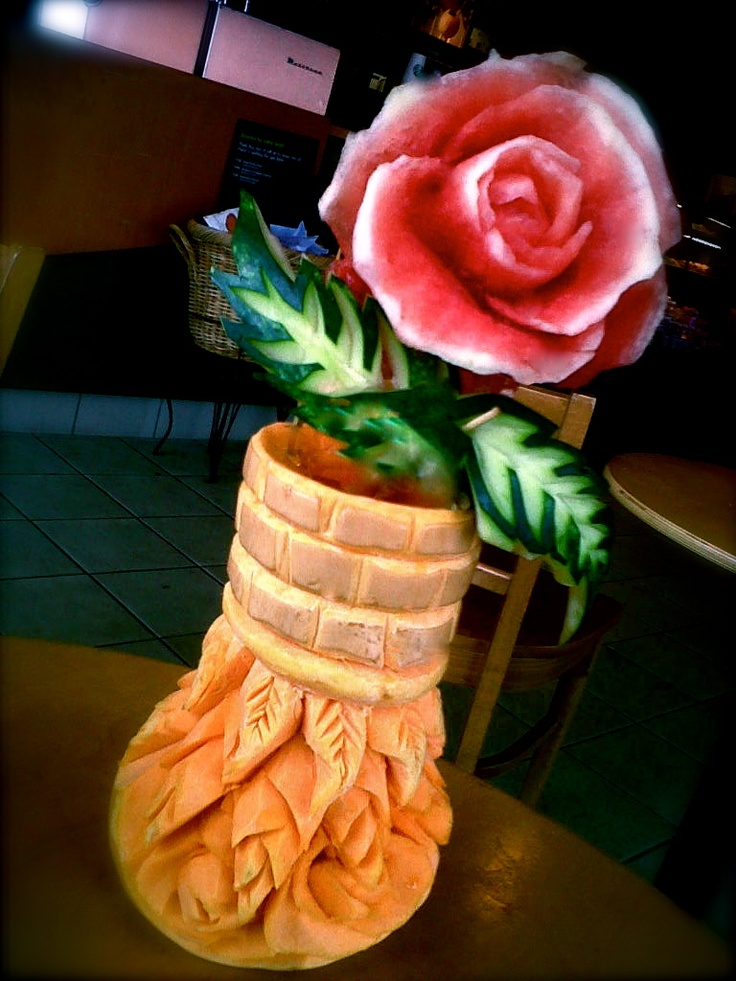 freehand carving of watermelon 'rose' in a butternut squash vase.... by Carl Jones