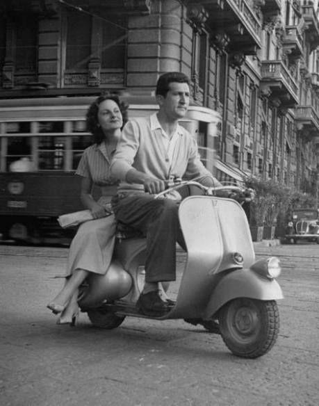 Vintage photo of a couple riding a Vespa