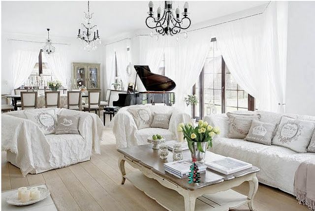 fabulous look of white and cream tablecloths, bedspreads etc. draped over furniture