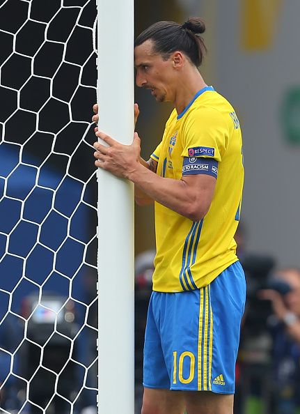 A frustrated looking Zlatan Ibrahimovich of Sweden holds onto the goal post during the UEFA EURO 2016 Group E match between Italy and Sweden at...