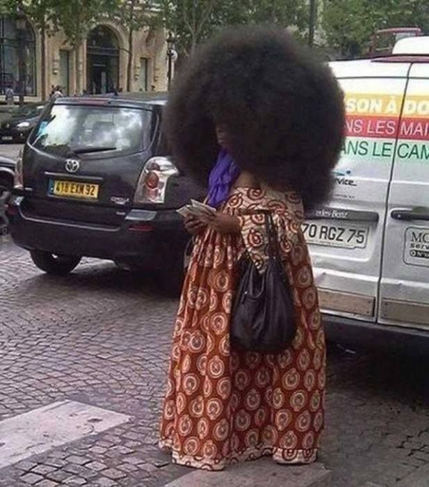 Aevin Dugas, 37, a social worker from Napoleanville, Louisiana, has the world's largest afro. Her hair made The Guinness Book of Records at 4ft 4ins (132 cm) around.