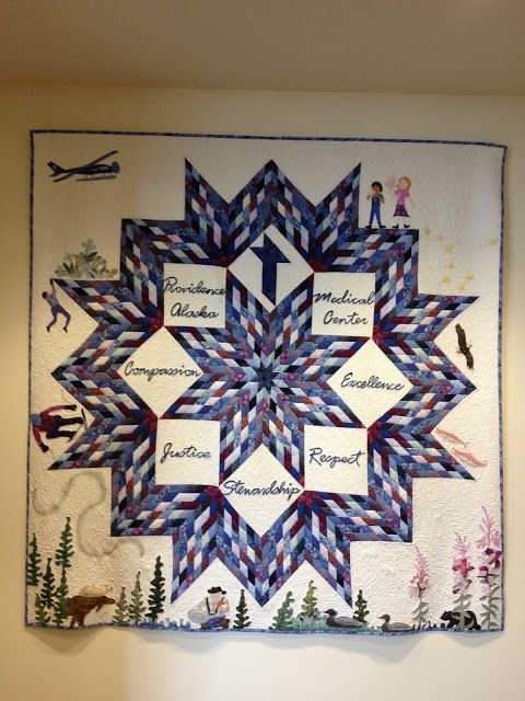 This Lemoyne Star with appliqued border was quilted by Marit Anderson and hangs in the Providence Alaska Medical Center. (Quilters Dream Request)