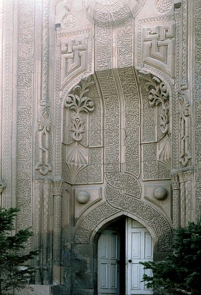 Image TUR 0421 featuring facade from the Ince Minare Medrese, in Konya, Turkey, showing Geometric PatternFloriated Arabesque and Calligraphy using carved masonry or stone relief.