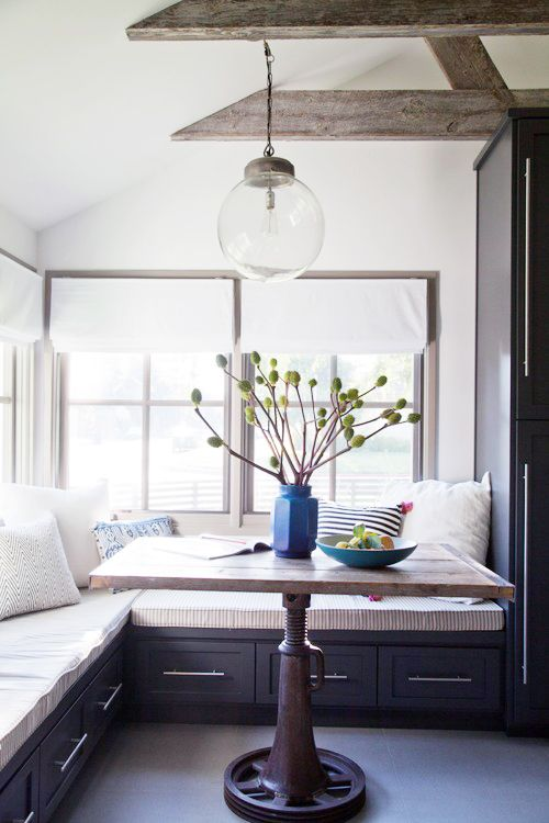 You'll Envy This Effortlessly Cool Family Home // glass pendant light, blue vase, industrial farm table, built-in sofa