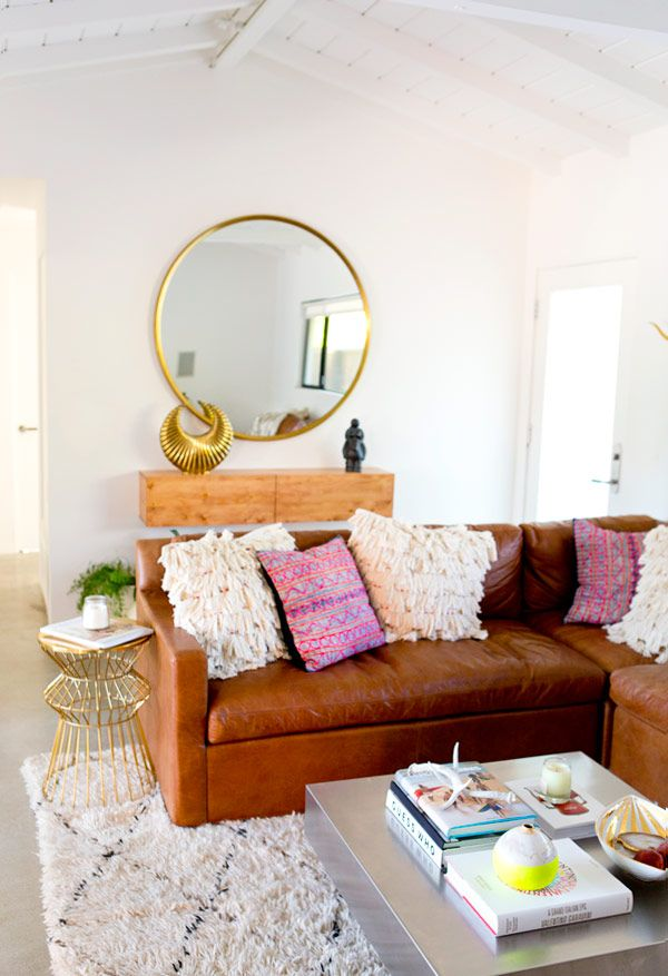 Comfy Life With A Tan Leather Sofa And Gold Coloured Accessories