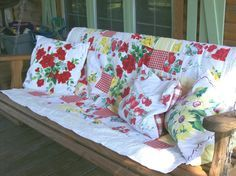 Decorate porch swing using vintage tablecloths for everything!