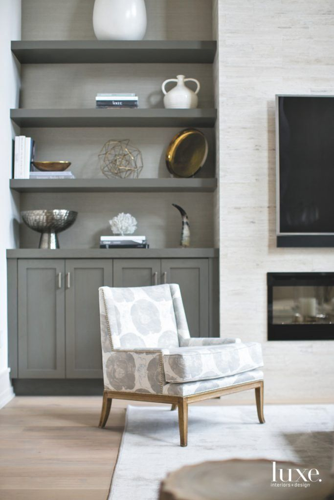 Gray cabinets, television, and a comfy chair make the perfect living room setting.