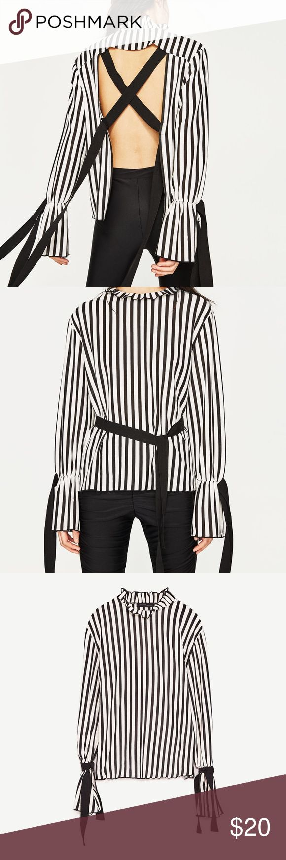 Zara top Open back top with ties in the back. Bell sleeves with top. This top is perfect for holiday parties. Zara Tops Blouses