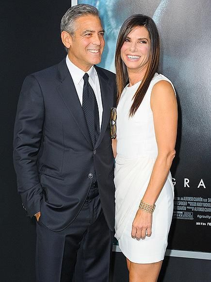 George Clooney lets a glowing Sandra Bullock take the spotlight at the N.Y.C. premiere of their new space drama, Gravity. http://www.people.com/people/gallery/0,,20740803,00.html