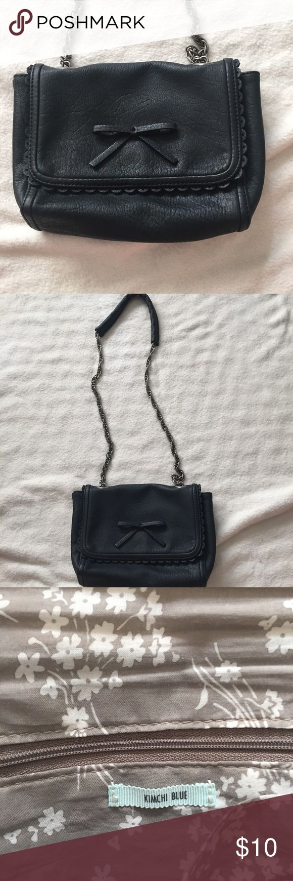 Navy purse from urban outfitters Navy purse with cute scalloped detailing. It's in great condition in exception to a barely noticeable stain by the magnetic closure. It would be a great addition to everyday summer outfits. Price negotiable, bundle to save! Urban Outfitters Bags