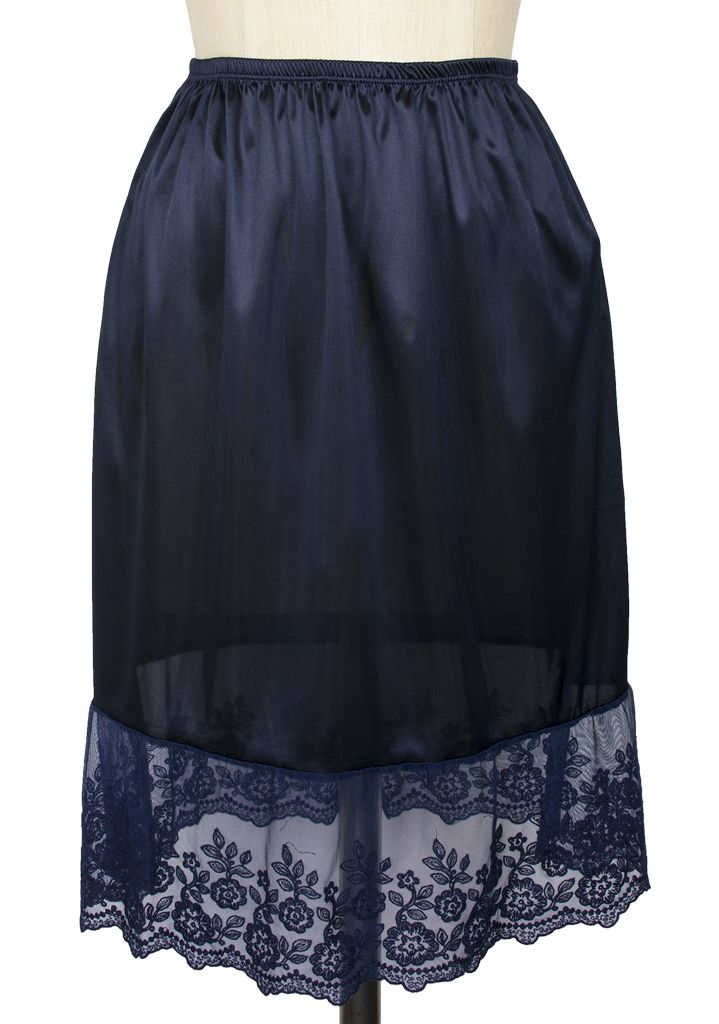 Keep cool this summer when you slide into the Embroidered Flower Slip from Melody! This slinky, silky underskirt is crafted from navy satin in a retro-inspired design that's perfect for layering under your favorite Trashy Diva dress. The semi-sheer hem is embroidered with a delicate floral pattern, scalloped at the edges in a vintage-inspired design that that looks darling peeping out from under your skirts or worn solo with a retro-inspired boudoir ensemble.