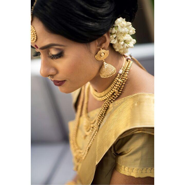 South Indian bride. Temple Indian bridal jewelry. Jhumkis.Gold silk kanchipuram sari.Braid with fresh jasmine flowers. Tamil bride. Telugu bride. Kannada bride. Hindu bride. Malayalee bride.Kerala bride.South Indian wedding.