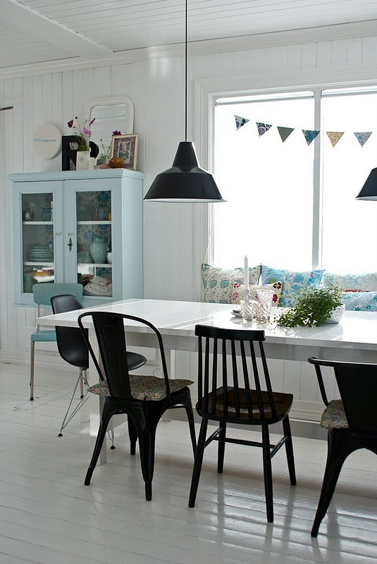 Love the idea of different chairs for around the dinning room table i like the bunting too!