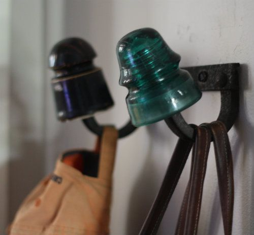 Repurposed insulators coat rack
