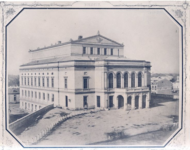 Teatrul National din Bucuresti, inaugurat in 1852 pe Podul Mogosoaiei (actuala Calea Victoriei). Bombardat de nazisti in august 1944, a fost ulterior demolat in 1946. Comunistii au construit un nou Teatru la Universitate, inaugurat in 1973. In prezent, aici se gaseste hotelul Novotel, care replica intrarea in vechiul Teatru.  Source: Ludwig Angerer