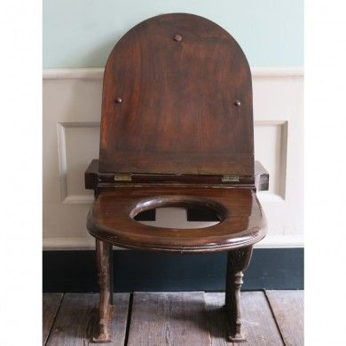 a mahogany toilet seat and cover