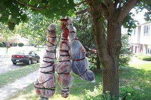 Litter the lawn with some body bag decor. | 27 Disgustingly Awesome Ways To Take Halloween To The Next Level