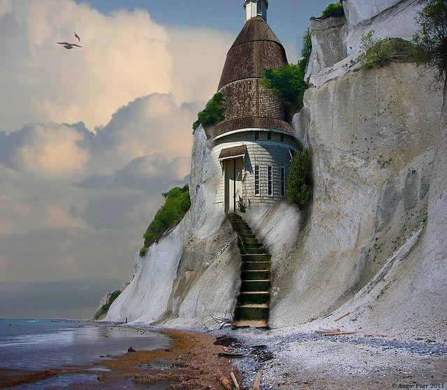 Lighthouse built into a chalk cliff.