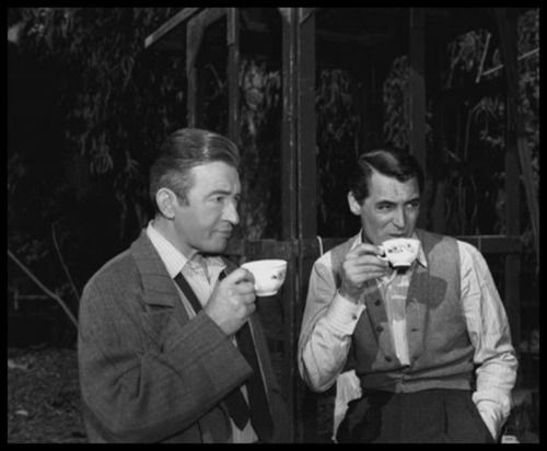 Co-stars CARY GRANT & CLAUDE RAINS having tea between scenes on the set of NOTORIOUS (1946), directed by Alfred Hitchcock.